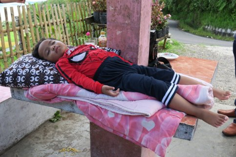 sleeping child of the indonesian tourist family
