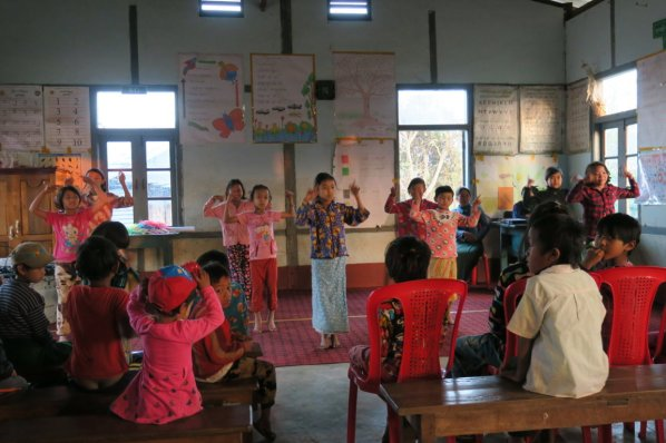 school children practicing a dance