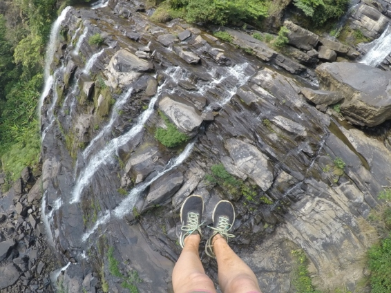 hanging over a waterfall